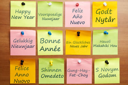 Happy new year word writed on post it in 12 languages photo