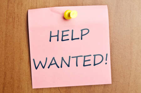 Help wanted word  post it on wooden wall photo