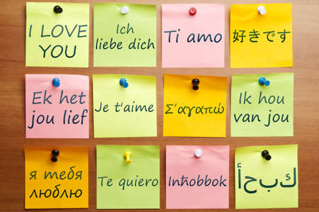 spanish language: I love you word made by post it in 12  languages Stock Photo