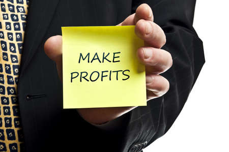 Make profits post it in business man hand photo