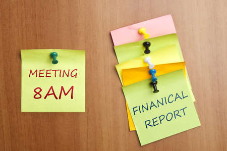 Meeting reminder post it on wooden wall Stock Photo - 8925535