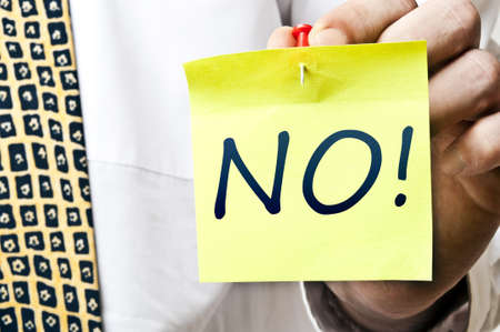 abstain: No! word post it in business man hand