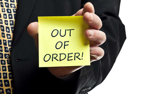 out of order: Out of order post it in business man hand