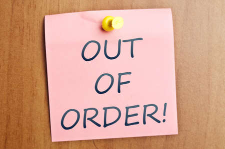 out of order: Out of order word  post it on wooden wall Stock Photo