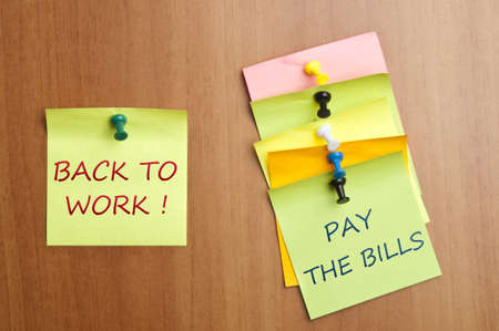 Back to work post it on wooden wall Stock Photo - 8925533