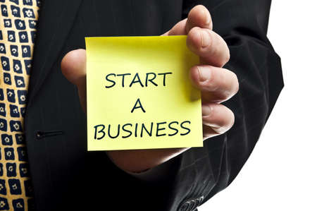 Start a business post it in business man hand photo