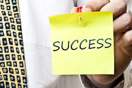 Success post it in business man hand photo