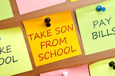 Take son from school post it on wooden wall Stock Photo - 8925558