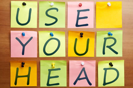 Use your head words made by post it Stock Photo - 8925496