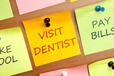 oral communication: Visit dentist post it Stock Photo