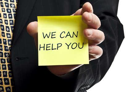you can: Podemos ayudarle a publicarla en la mano del hombre de negocios