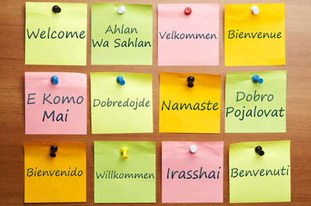 welcome sign: Welcome word post it in 12 languages Stock Photo