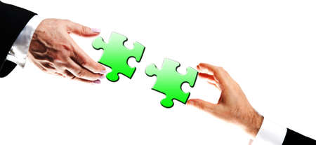 Puzzle pieces assembled by business people photo