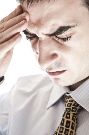 Isolarted business man expressing headache photo