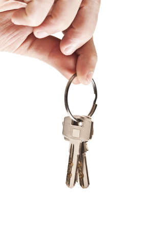 set of keys: Isolated male hand holding set of keys