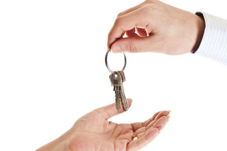 Agent man hand giving keys to woman photo
