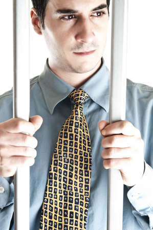 Isolated business man in jail photo