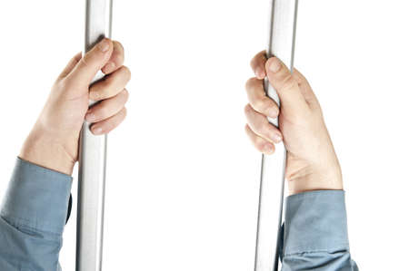 Isolated hands on jail bars Stock Photo - 8992147