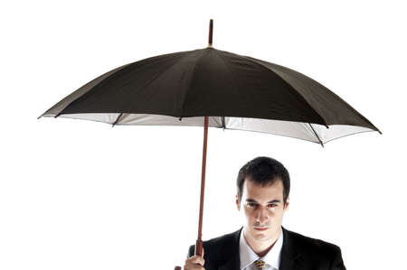 Isolated business man with umbrella photo