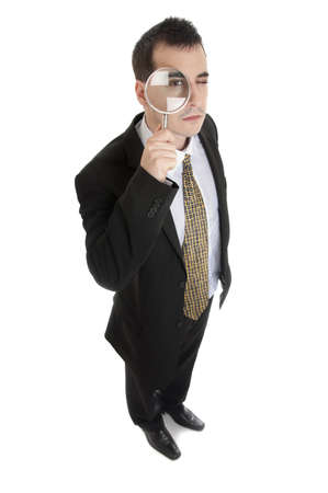 reading glasses: Business man with magnifying glass Stock Photo