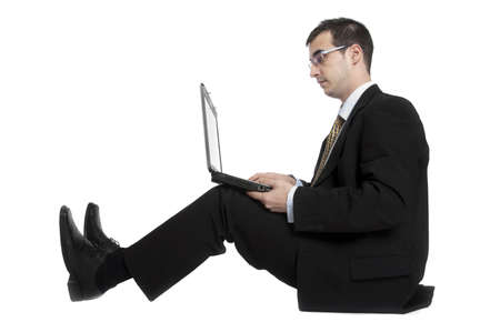 Isolated young business man on white photo