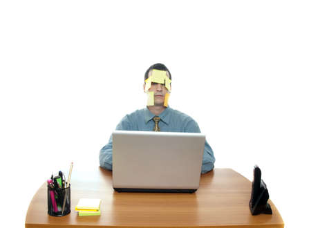 Isolated worker at office desk on white background photo