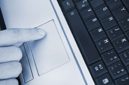 Man hand on pc keyboard photo