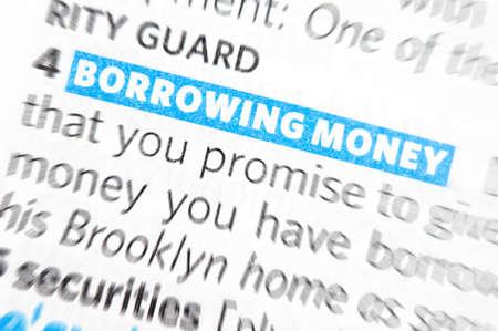 borrowing: Borrowing money words close up in dictionary