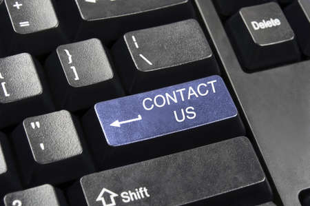 Contact us key in place of enter key Stock Photo - 9140374