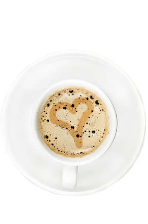 Love sign on cup of coffee photo