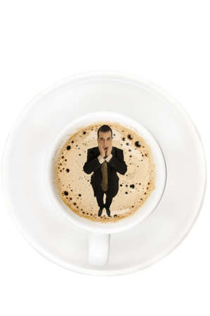 Surprised man on cup of coffee photo