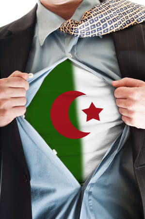 Algeria: Business man showing  Algeria flag shirt Stock Photo