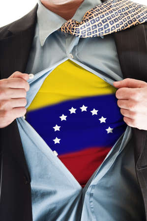 Business man showing Venezuela flag shirt photo