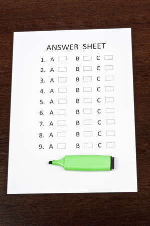 Answer sheet and green marker Stock Photo - 9199864