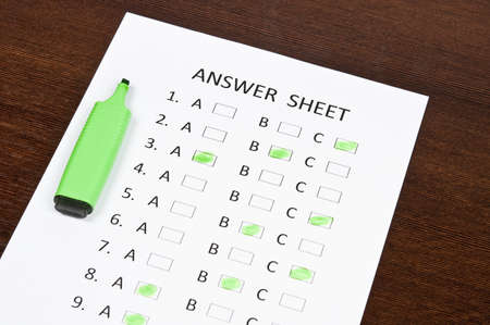 Answer sheet and green marker Stock Photo - 9199826
