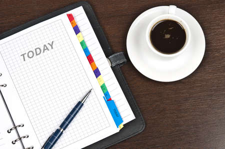 appointment book: Closeup to agenda and coffee