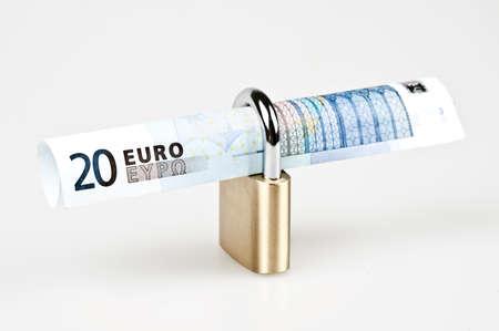 Euro banknotes in closed padlock photo