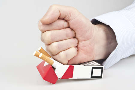 renounce: Man punch in cigarettes pocket Stock Photo
