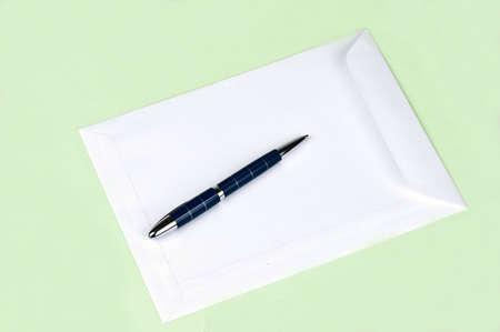 White envelope on green background photo