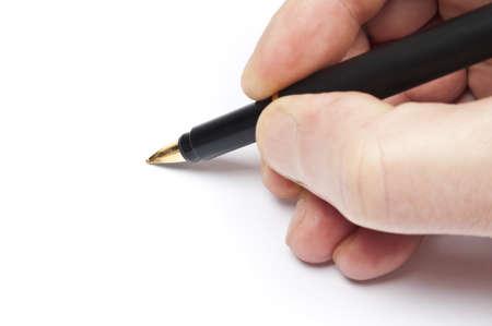 escribiendo: Mano de hombre escribir con l�piz negro Foto de archivo