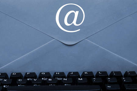 Envelope with @ sign on keyboard Stock Photo - 9221124