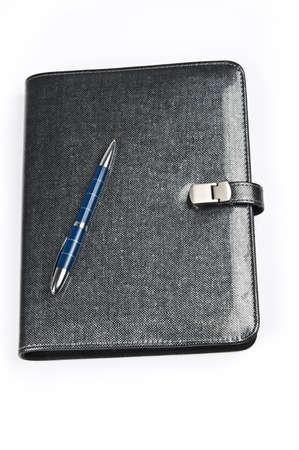 Isolated closed agenda and pen photo