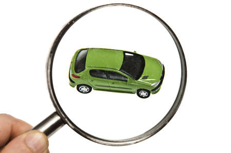 expertise concept: Magnifyng glass on green car