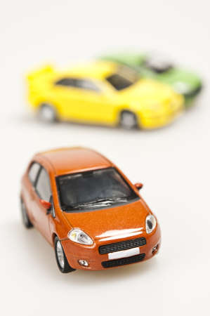 Three toy cars on white photo