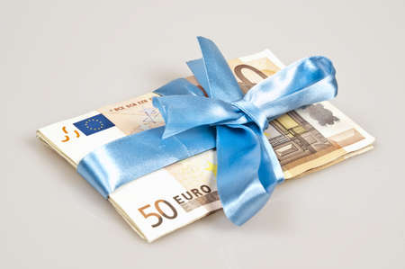 Cash present with blue ribbon photo