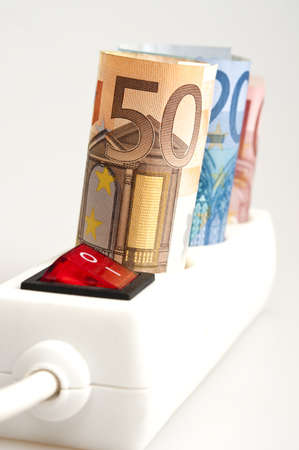 Euro banknotes on power outlet photo