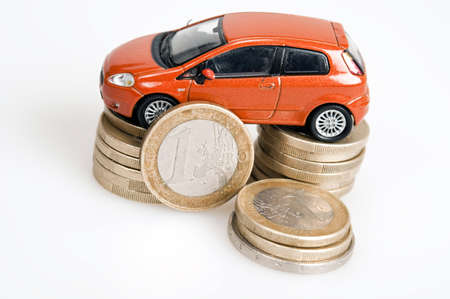 Toy car on euro coins photo