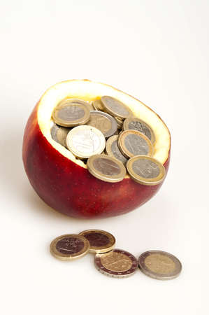 Many coins inside red apple Stock Photo - 9219102