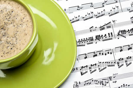 Coffee and musical score closeup photo