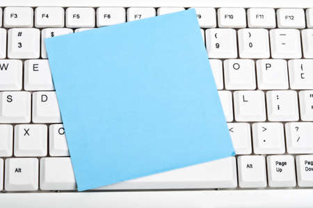 Post-it on an white keyboard Stock Photo - 9253148